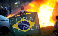 Students protest in front of the Congress in Brasilia against the bill that freezes government spending for 20 years, on November 29, 2016 Brazilian riot police fought an angry crowd of demonstrators outside Congress on Tuesday as lawmakers prepared to vote on austerity measures freezing government spending for 20 years. / AFP PHOTO / ANDRESSA ANHOLETE